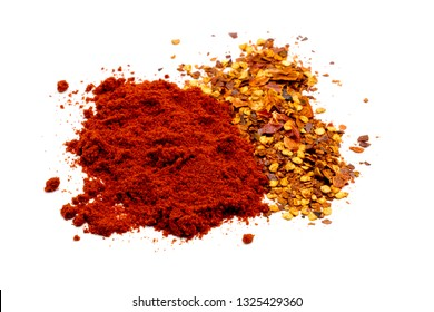 closed up red Paprika powder and crushed dried red hot chili pepper on white background