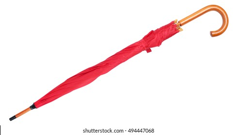 closed red umbrella on white