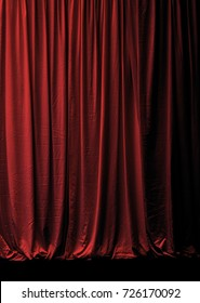 closed red velvet stage curtain
