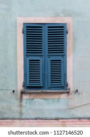 Closed retro window exterior with closed wooden shafts