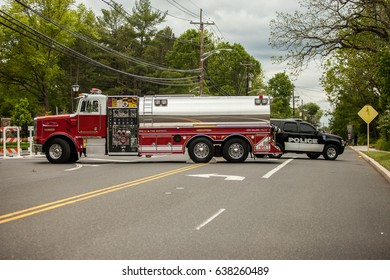 Closed road with police car and fire truck
