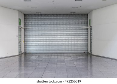 closed roller shutter at a shop without people
