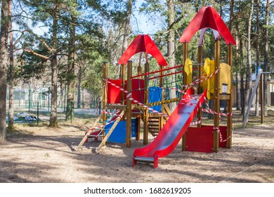 Closed, roped off children's playground amid COVID-19 Coronavirus pandemic in Europe