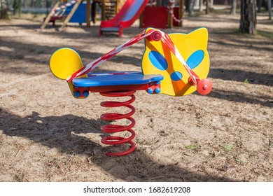Closed, roped off children's playground swinging cat toy amid COVID-19 Coronavirus pandemic in Europe