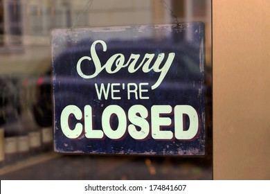 a closed shop has a sign in the schauf nests. sorry, we're closed