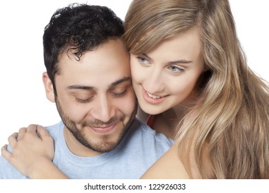 Closed up shot of embracing couple over white background