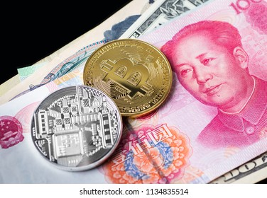 closed up shot of physical coin with B sign alphabet on face of Chinese yuan banknote.