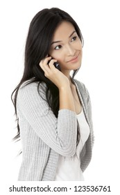 Closed up shot of a smiling lady while calling through her cellphone isolated in a white background