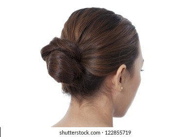 Closed up shot of woman coiffure with bun isolated in a white background