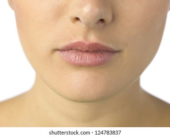 Closed up shot of woman lips with pink lipstick