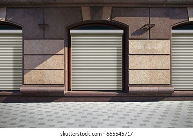 closed shutters on show window of shop