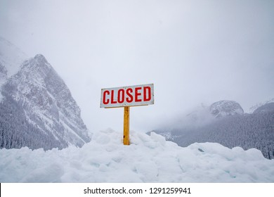 Closed Sign. Closed due to bad weather.