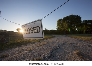 CLOSED: Sign hanging across a road