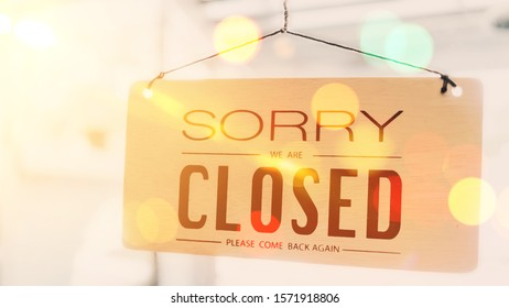 Closed sign hanging front of cafe mirror door. Business service and food drink concept. Vintage tone filter effect color style.