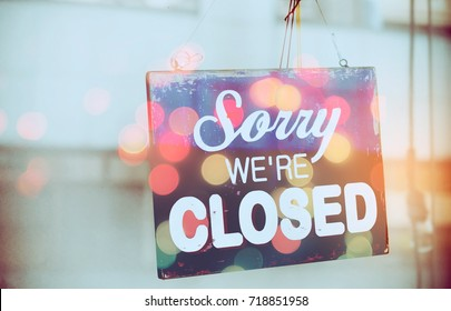 Closed sign hanging front of mirror door coffee shop double exposure with colorful bokeh light abstract background. Food drink and business service concept. Vintage tone filter color effect style.