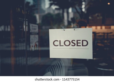 Closed sign on a glass door