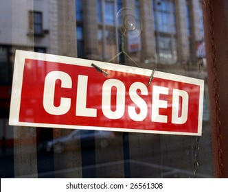 Closed sign in a shop showroom with reflections