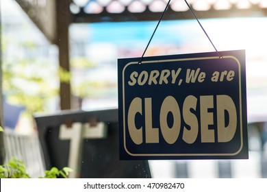 "Closed sign.""Sorry we are closed"""