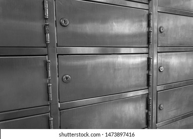 Closed up stainless PO boxes in a post office without numbering