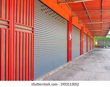 Closed steel shutter door of warehouse, storage or storefront for background and textured.
