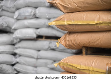 Closed up Storehouse with stacked sacks of chemical product.