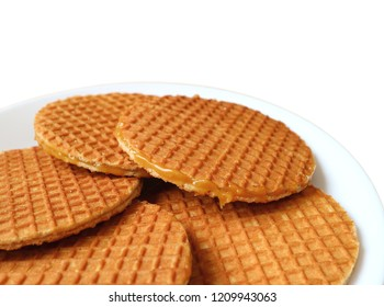 Closed up Stroopwafel Cookies, Tasty Dutch Traditional Sweets Served on White Plate Isolated on White Background with Free Space for Text and Design