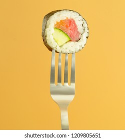 closed up sushi roll with tuna, salmon and cucumber