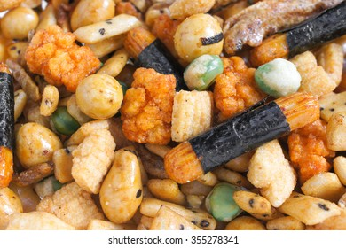 Closed up Texture / Pattern of Japanese Rice Crackers, nuts and dried fish. Japanese common snack also known as Arare or Otsumami, Selective Focus