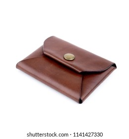 A closed vegetable tanned leather coin purse on a white background