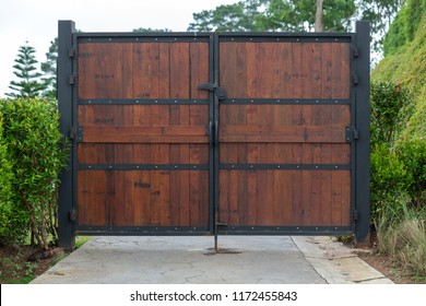 closed vintage wooden and metal plate gate.