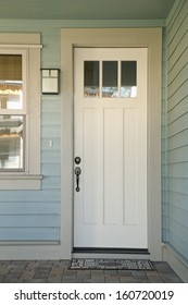 Closed white front door of a house during daytime