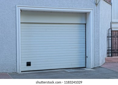 closed white gates on the facade of the garage