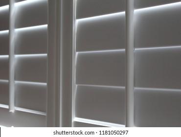 Closed white plantation shutters