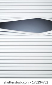 Closed white venetian blinds with a peeking hole and copy space.