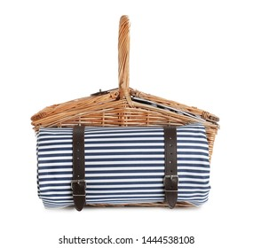Closed wicker picnic basket with blanket on white background