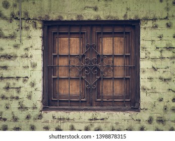 Closed window in abandoned house