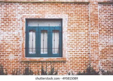 closed window in a brick wall