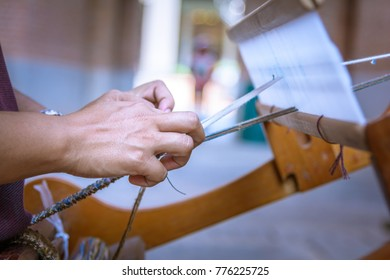 Closed up Woman hand manual weaving cotton.