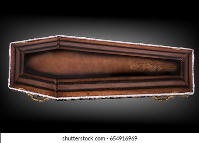 closed wooden brown coffin covered with cloth isolated on gray luxury background. casket with shadow on background.