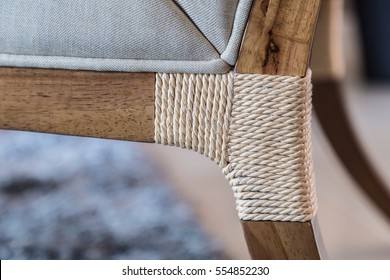CLOSED UP WOODEN CHIR WITH RATTAN DETIAL ON LEGS FURNITURE DETAIL IDEAS CONCEPT