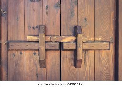 closed wooden door with locking bar - vintage
