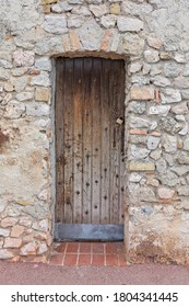 Closed Wooden Door at Old Stone Building