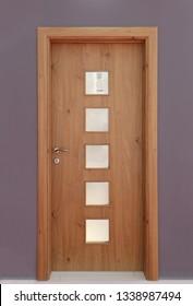 Closed wooden room door entrance inside modern interior