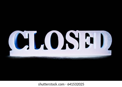 Closed word on black background