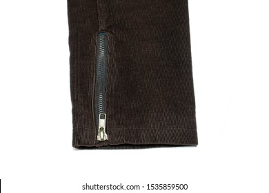 Closed zipper on the sleeve of a corduroy jacket on a white background