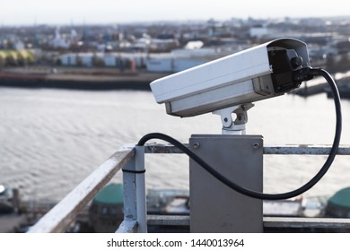 Closed-circuit television camera mounted on a rooftop of a port building in Hamburg harbor, Germany