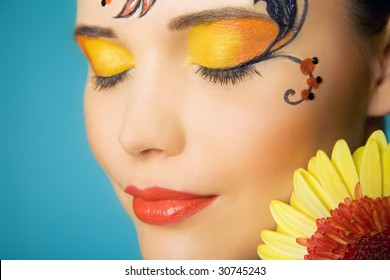 closed-eyes woman with paint of khokhloma on her head