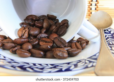 Closed-up coffee beans in the cup.