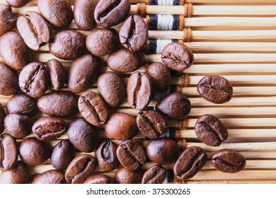 Closed-up Coffee beans on bamboo background