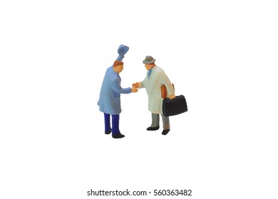Closed-up figure of businessmen shaking hands, isolated on white background